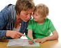 A mom helps a child with Down's Syndrome with homework. (Photo: EVAfotografie/ istockphoto.com)