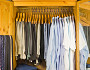 Clothing grouped by type and color. Photo of an orderly closet by vandervelden/istockphoto.com.